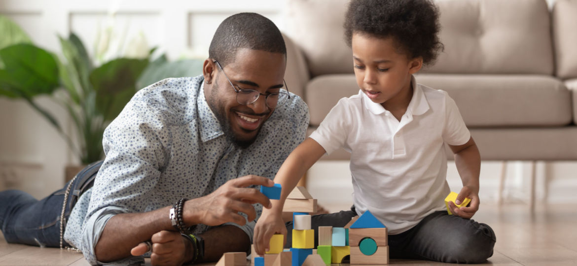 Happy african dad and child son building constructor from blocks